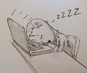 A tired man sleeping on his laptop computer.