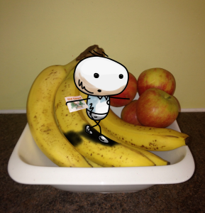 The cartoon drawing boy Sid Smart is walking and balancing along a banana in a fruit bowl. Author and illustrator.