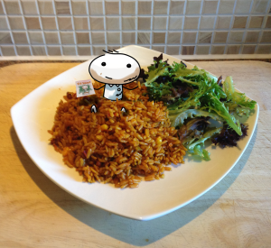 Sid Smart (the cartoon boy) loves healthy food and is sat in a pile of brown, wholegrain rice.