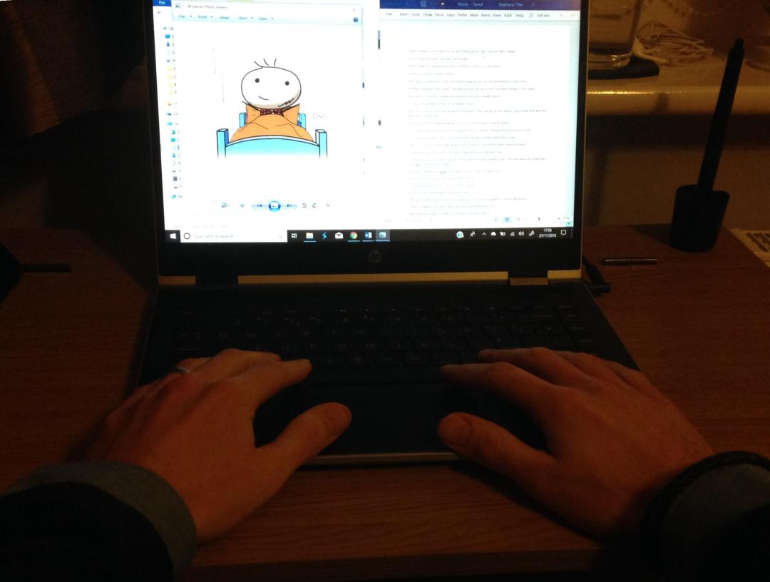 A picture of a person typing on a laptop. The author and illustrator of Sid Smart - the children's book about health and nutrition.